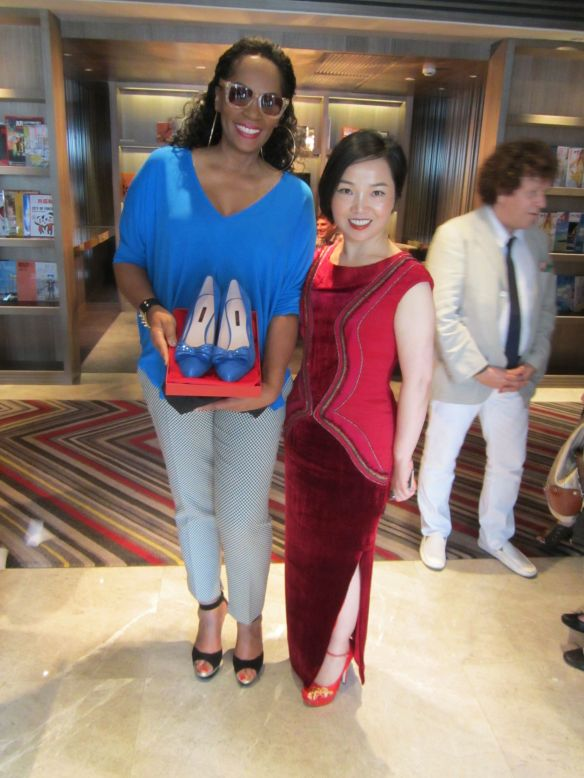 Getting presented a custom pair of shoes by Sheme, high end shoe designer of China