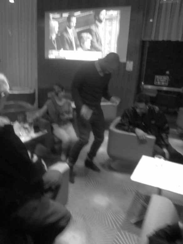 Bryan Chammbers having fun swapping shoes with Anders Knudsen. © 2014 Jody Watley
